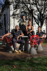 Tylonn J. Sawyer, Rashaun Rucker, Sydney G. James and Scheherazade Washington Parrish  are members of the Vanguard Artist Collective and pose for a portrait outside of the Detroit Institute of Arts on Tuesday, Oct. 8, 2019. All three visual artists, Rucker, Sawyer and James are opening a solo show this month and Parrish is is an educator and writer with the James and Grace Lee Boggs School in Detroit.