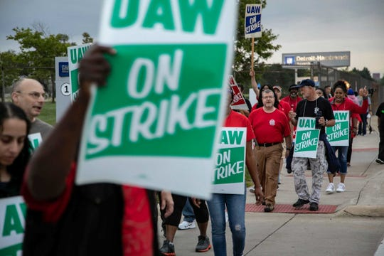 UAW strikers with Local 22 take to the streets outside of GM Detroit-Hamtramck Assembly Monday, Sept. 16, 2019.