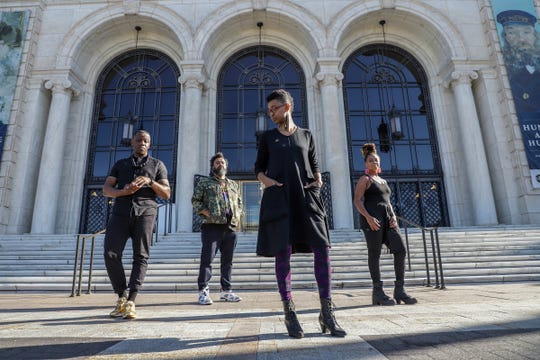 Tylonn J. Sawyer, Rashaun Rucker, Scheherazade Washington Parrish and Sydney G. James are members of the Vanguard Artist Collective and pose for a portrait outside of the Detroit Institute of Arts on Tuesday, Oct. 8, 2019. All three visual artists, Rucker, Sawyer and James are opening a solo show this month and Parrish is is an educator and writer with the James and Grace Lee Boggs School in Detroit.