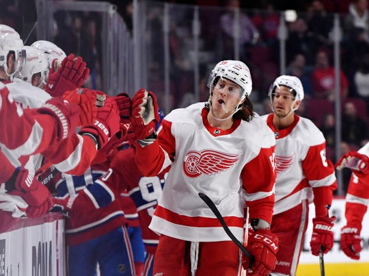 Detroit Red Wings' Tyler Bertuzzi celebrates with teammates after scoring a goal against the Montreal Canadiens during the first period at the Bell Centre, Oct. 10, 2019.