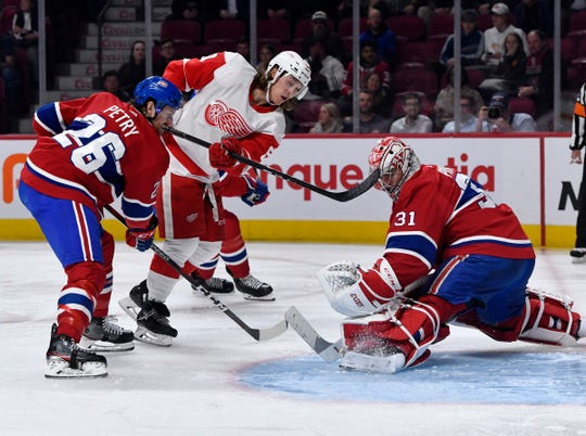 Montreal Canadiens' Carey Price and  Jeff Petry stop Detroit Red Wings forward Tyler Bertuzzi during the second period at the Bell Centre, Oct. 10, 2019.