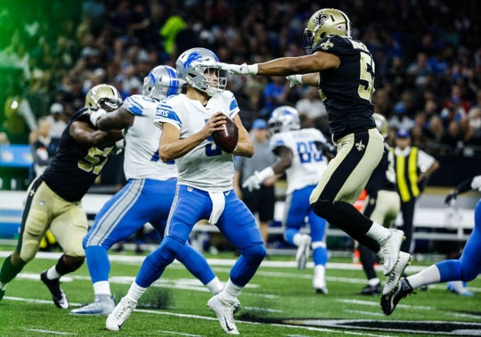 New Orleans Saints outside linebacker Craig Robertson (52) pressures and strips Detroit Lions quarterback Matthew Stafford (9) of the football during the first half of a game at the Mercedes-Benz Superdome.