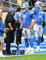 Detroit Lions head coach Matt Patricia talks with Matthew Stafford on the field before action against the New England Patriots Friday, August 8, 2019 at Ford Field, in Detroit.