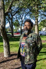 Rashaun Rucker is a visual artist and member of the Vanguard Artist Collective and poses for a portrait outside of the Detroit Institute of Arts on Tuesday, Oct. 8, 2019.