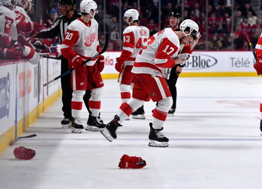 Detroit Red Wings defenseman Filip Hronek (17) leaves the ice after getting injured during the third period against the Montreal Canadiens at the Bell Centre in Quebec, Oct. 10, 2019.