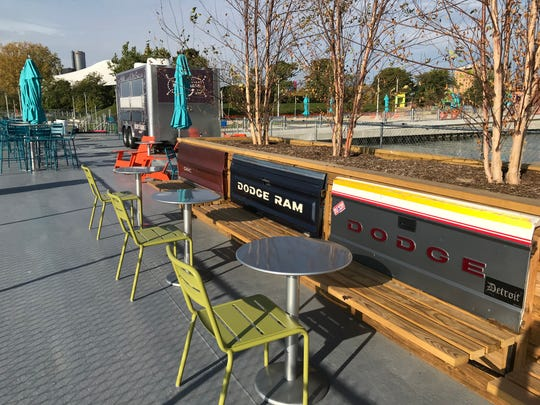 The playful design at the new Robert C. Valade Park on the Detroit RiverWalk includes using the tailgates of old pickup trucks part of bench seating.
