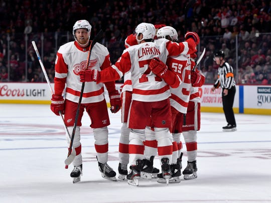 Wings forward Anthony Mantha, left, celebrates after scoring a goal against the Canadiens during the second period at the Bell Centre, Thursday.