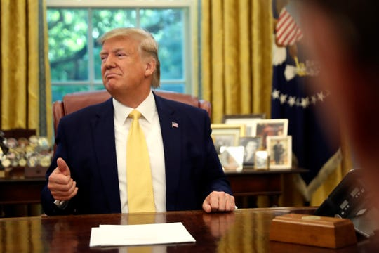 President Donald Trump listens he meets with Chinese Vice Premier Liu He in the Oval Office of the White House in Washington, Friday, Oct. 11, 2019.