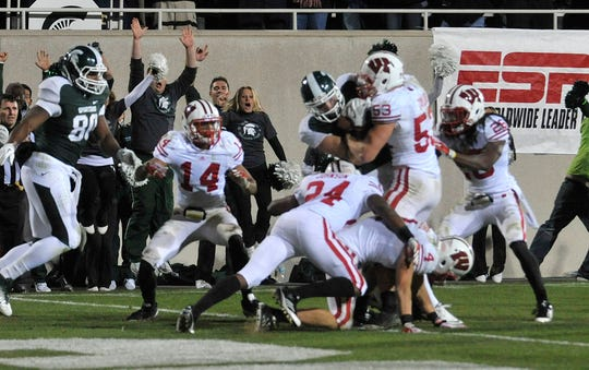 Keith Nichol powers over the goal line after catching a deflected Hail Mary pass as Michigan State defeats Wisconsin 37-31 in 2011.