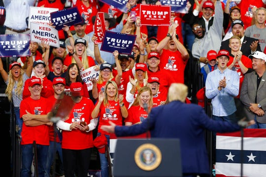 Supporters cheer as President Donald Trump acknowledges them during a campaign rally Thursday, Oct. 10, 2019, in Minneapolis.