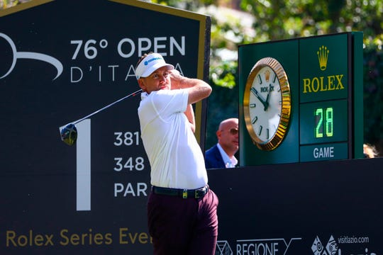 Ian Poulter tees off at first hole during the second day of the Italian Open in Rome on Friday.
