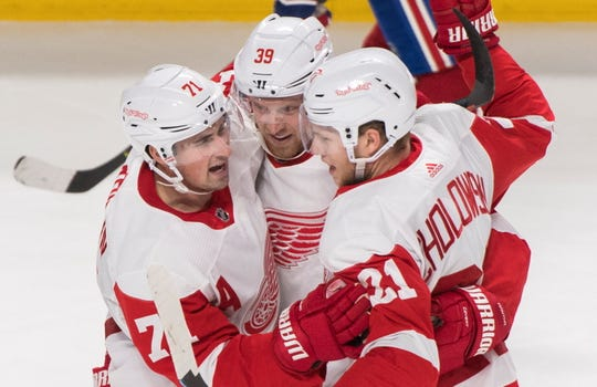 Detroit Red Wings' Anthony Mantha (39) celebrates his goal with teammates Dylan Larkin (71) and Dennis Cholowski (21) during the second period on Thursday.