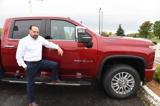 Mark Montante, general manager at Taylor Chevrolet, stands beside a 2020 Silverado 2500 HD High Country at the dealership.