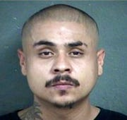 This undated photo provided by the Kansas City Kansas Police Department shows Hugo Villanueva-Morales.