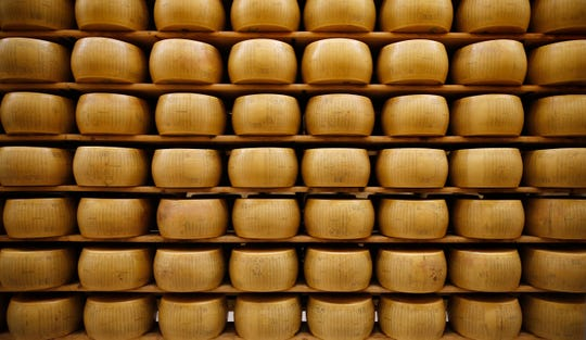 Parmigiano Reggiano Parmesan cheese wheels are stored in Noceto, near Parma, Italy.