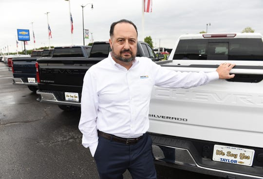 Mark Montante, general manager at Taylor Chevrolet, stands in front of a 2020 Silverado 1500 Z71  at the dealership.