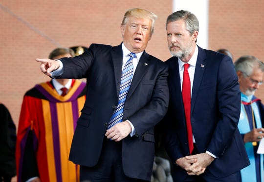 In this May 13, 2017 file photo, President Donald Trump speaks with Liberty University president, Jerry Falwell Jr. during commencement ceremonies at the school in Lynchburg, Va.
