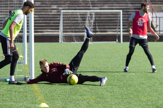 Detroit City FC goalkeeper Nate Steinwascher makes a stop during practice Thursday at Keyworth Stadium. Steinwascher is riding a three-game shutout streak heading into Saturday's Members Cup match against the New York Cosmos.
