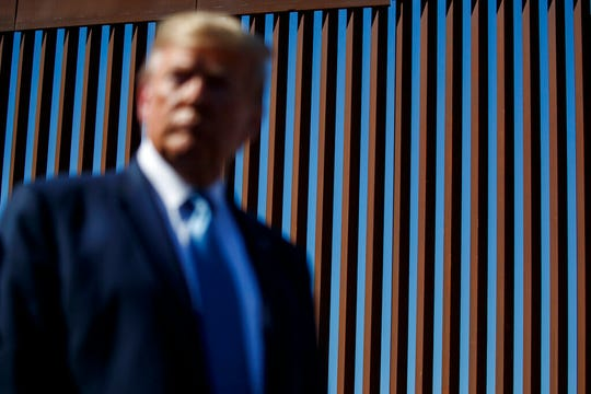 President Donald Trump tours a section of the southern border wall in this Sept. 18, 2019, file photo in Otay Mesa, Calif.  A federal judge in Texas said he would block Trump's plan to build a border wall with funds shifted from the Pentagon's construction budget.