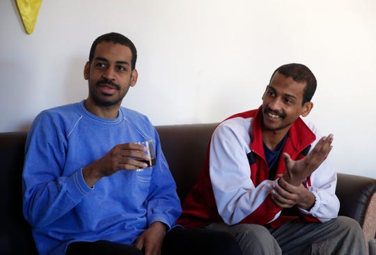 """FILE - In this March 30, 2018, file photo, Alexanda Amon Kotey, left, and El Shafee Elsheikh, who were allegedly among four British jihadis who made up a brutal Islamic State cell dubbed """"The Beatles,"""" speak during an interview with The Associated Press at a security center in Kobani, Syria. The men said that their home country's revoking of their citizenship denies them a fair trial. """"The Beatles"""" terror cell is believed to have captured, tortured and killed hostages including American, British and Japanese journalists and aid workers."""