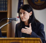 Michigan Attorney General Dana Nessel answers questions from the media in this Sept. 23, 2019, file photo. Nessel is making an emergency appeal to a federal judge, asking him to pause his decision allowing faith-based adoption agencies to continue contracting with the state despite their refusal to work with gay couples.