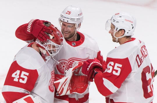 Red Wings goaltender Jonathan Bernier celebrates with teammates Mike Green (center) and Danny DeKeyser after the win over Montreal on Thursday.