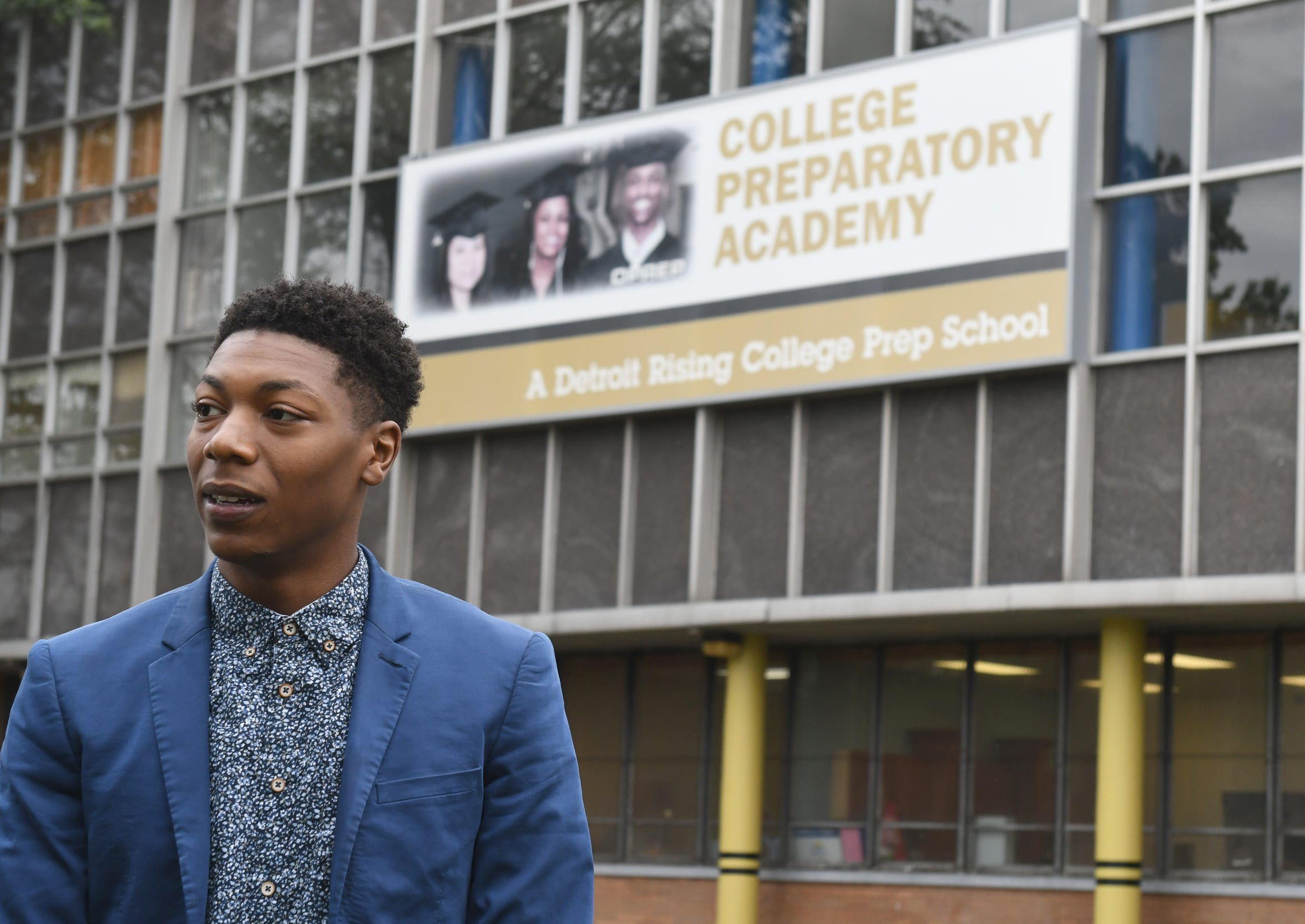 Jamarria Hall stands outside Osborn High School. Hall is a DPS graduate and plaintiff in a lawsuit against the State of Michigan alleging a lack of access to literacy in Detroit's schools.