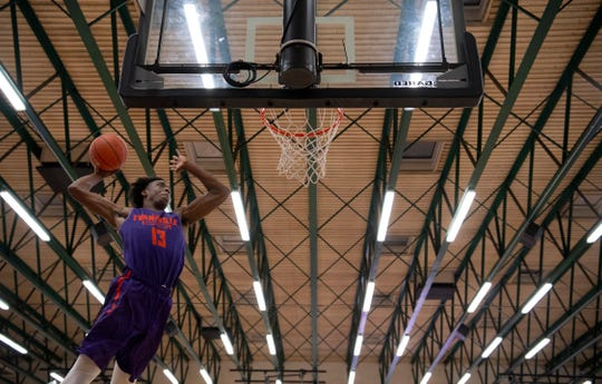 Deandre Williams dunks in the slam dunk competition at Hoopsfest in the Meeks Family Fieldhouse Thursday night.