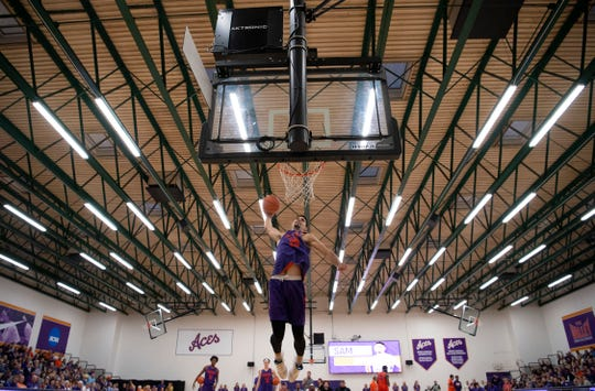 Sam Cunliffe dunks during the slam dunk contest at Hoopsfest in the Meeks Family Fieldhouse Thursday night.