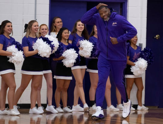 University of Evansville basketball coach Walter McCarty makes his entrance at Hoopsfest in the Meeks Family Fieldhouse Thursday night.