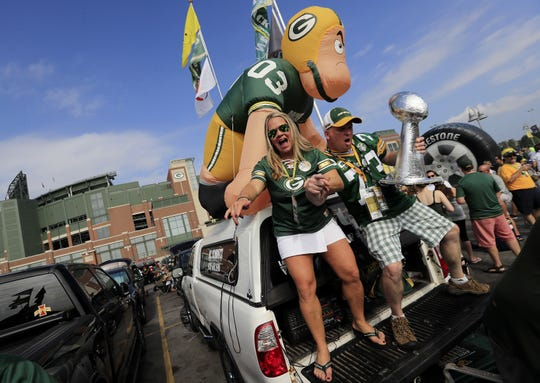 Packers fans tailgate outside Lambeau Field in 2018.