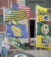 "Flags fly outside a tailgate at Lambeau Field before a ""Monday Night Football"" game in 2018."
