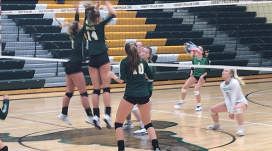 C.M. Russell's Allie Olsen (14) successfully finishes off Norah Allen's 17th straight service point in the third game as the Rustlers swept Belgrade Thursday night at CMR.