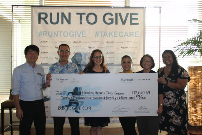 The Westin Resort Guam and Sheraton Laguna Guam Resort presented a check for $12,620.69 to the Healing Hearts Crisis Center on Wednesday