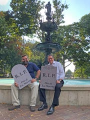 "Abraham Brown, left, director of Hispanic outreach and ministry at Holy Name of Jesus Catholic Church, and Henderson County Judge-executive Brad Schneider show off a couple of the ""tombstones"" that will be available in a ""graveyard"" that will be set up for a celebration of the Mexican Dia de Los Muertos (Day of the Dead) holiday in Henderson's Central Park on Saturday, Nov. 2. Much as many Americans will remember their dearly departed on All Saints' Day on Nov 1, many Mexicans visit the graves of their late loved ones to picnic and take favorite treats to those who have passed."