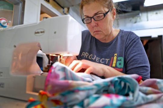 Kathleen Merchant works at Project Lia, in the Circle City Industrial Complex, Thursday, Sept. 19, 2019.  Merchant was helped by The Bail Project.  The national nonprofit is now in Indianapolis.  It pays the bail for low-level offenders who otherwise wouldn't be able to afford bail and would have to await trial in jail.  They paid Merchant's $500 bail to get her released in June, 2019.  Her case has since been dismissed.  Now Merchant works with Project Lia which provided transitional employment for women involved with the criminal justice system.