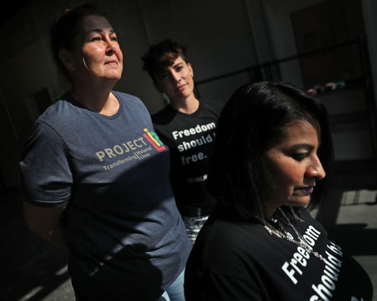 Kathleen Merchant, from left, April Angermeier, and Devi Davis stand together in the Circle City Industrial Complex, Thursday, Sept. 19, 2019.  Davis and Angermeier are with The Bail Project.  The national nonprofit is now in Indianapolis.  It pays the bail for low-level offenders who otherwise wouldn't be able to afford bail and would have to await trial in jail.  Merchant was one of the people helped by The Bail Project.  They paid her $500 bail to get her release in June, 2019.  Her case has since been dismissed.