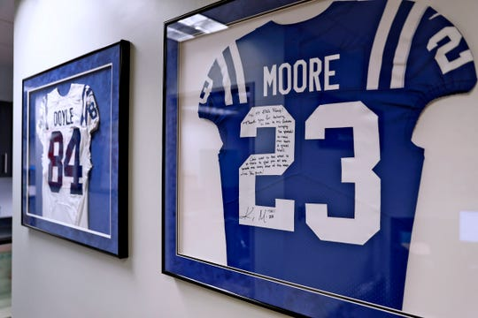 Signed jerseys of Colts tight end Jack Doyle, left, and cornerback Kenny Moore II hang in sports agent Buddy Baker's offices, Friday, Oct. 11, 2019.  Baker is President and CEO of Exclusive Sports Group, LLC.