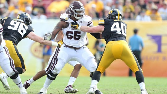 Mississippi State offensive lineman Greg Eiland blocks Iowa defenders in last year's Outback Bowl. Eiland plays in memory of his best friend, Josten Baxstrum, who died on Nov. 24, 2018.