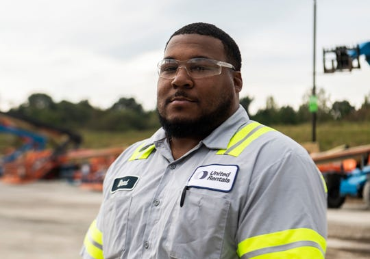 Veteran Bradford Bady stands in the United Rentals lot in Jackson, Tenn. where he recently started a new career as an equipment service technician with the help of nonprofit Workforce Opportunity Services.