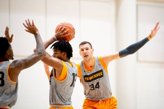 Tennessee forward Uros Plavsic (34) defends against Tennessee guard Jalen Johnson (13) during a Tennessee men's basketball media day practice inside Pratt Pavilion in Knoxville, Tenn. on Friday, October 11, 2019.