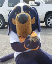 Sinan with Smokey at a UT rowing event