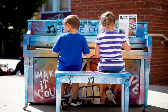 Dylan, 5, and Phoebe, 4, of Knoxville, whose parent did not want to share their last names, play a piano part of the Piano Project of Knoxville in Market Square in Knoxville, Tenn. on Friday, October 11, 2019. The project was started by local jazz pianist Brian Clay and painted by three local artists. The three pianos will be located in Market Square, Krutch Park and the 100 Block of Gay Street.