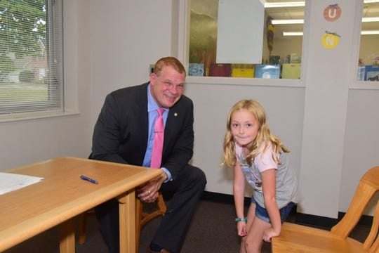 Mayor Glenn Jacobs with Ava Hope, 7, as she takes her seat to ask him which he likes better, being Kane the wrestler or Mayor Glenn Jacobs. 10/8/19