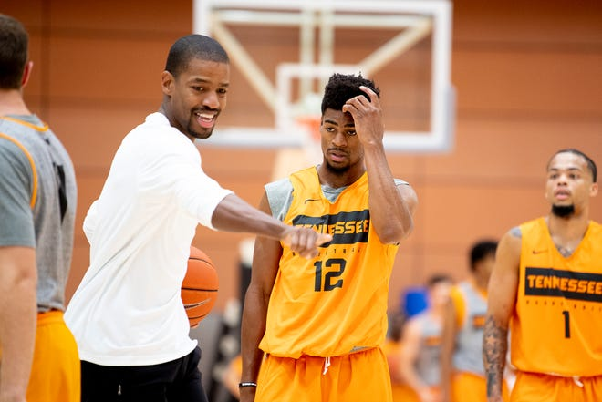 Assistant Coach Kim English coaches Tennessee guard Victor Bailey Jr. (12) during a Tennessee mens basketball media day practice inside Pratt Pavilion in Knoxville, Tenn. on Friday, October 11, 2019.