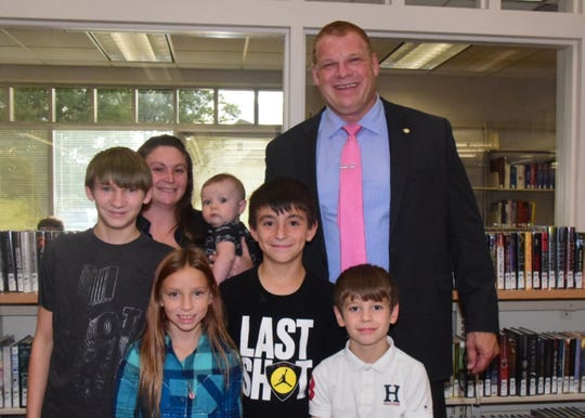 Mom Allyssa Mathias brought her kids – Parker Elliott, Kaylee Elliott, Thomas Mathias, Bentley Mathias, and Tytan Mathias – to meet Mayor Glenn Jacobs (also known as Kane, a WWE wrestler) at a constituents meeting at Karns Branch Library on Tuesday, Oct. 8.