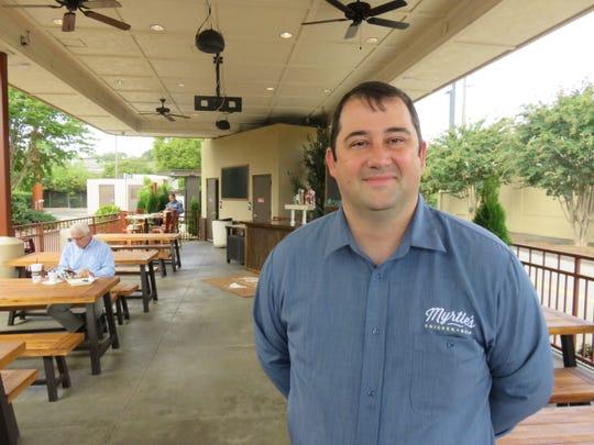 Myrtle's Chicken + Beer general manager Tyler Frank stands in the beer garden on Oct. 9.