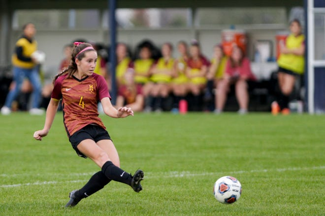 McCutcheon's Megan Merryman (4) kicks the ball into the goal to score during the second half of an IHSAA girls soccer sectional match, Thursday, Oct. 10, 2019 in West Lafayette. McCutcheon won, 4-1.