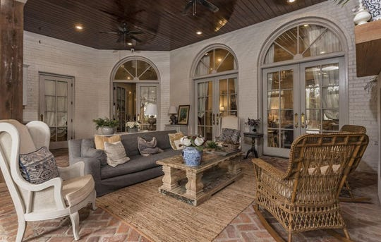 Live in old, southern style with all the modern amenities. This Antebellum South plantation style mansion, on the market for $1.5 million, sits on 17 acres with a mature crepe myrtle lined driveway, basketball court and full outside kitchen.