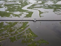 NEW ORLEANS, LA - AUGUST 23: The $1.1 billion Lake Borgne Surge Barrier stands near the confluence of and across the Gulf Intracoastal Waterway and the Mississippi River Gulf Outlet on August 23, 2019 in New Orleans, Louisiana.  The massive structure was built by the Army Corps of Engineers along with other reinforcements to defend the city of New Orleans against future hurricanes and storms. The nearly 2 mile long, 26 foot high barrier is designed to block deadly storm surge from Lake Borgne, similar to what ravaged the Lower Ninth Ward during Hurricane Katrina. According to researchers at the National Oceanic and Atmospheric Administration (NOAA), Louisiana's combination of rising waters and sinking land give it one of the highest rates of relative sea level rise on the planet. Since the 1930s, Louisiana has lost over 2,000 square miles of land and wetlands, an area roughly the size of Delaware. In the past 30 years, as subsidence continues and the effects of climate change increase, Louisiana has been losing its coastal landscape at the rate of almost a football fields worth of land every hour. (Photo by Drew Angerer/Getty Images)